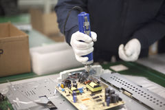 Electronics technician at work. Technician at work in the factory Stock Photo
