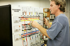 Electronics Training. An adult education student learning electronics on a Transformer Trainer Board royalty free stock photos
