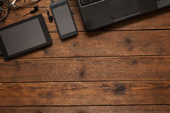 Electronics on wooden background Royalty Free Stock Images