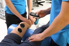 Electrostimulation, treatment and rehabilitation Stock Images
