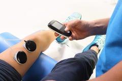 Electrostimulation, treatment and rehabilitation Stock Photography