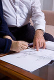 Elederly couple. Mature couple at work with some plans Royalty Free Stock Photo