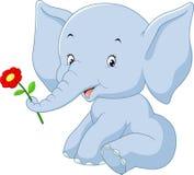 Elefante de la historieta que sostiene la flor Imagen de archivo