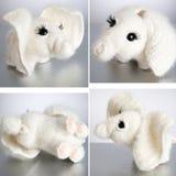 Elefante del juguete en fondo gris Fotografía de archivo libre de regalías