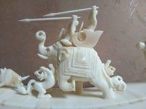 Elefante e tigre dell'osso di caccia Fotografia Stock