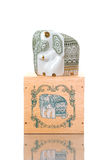 Elefante hermoso de la porcelana en la caja Imágenes de archivo libres de regalías