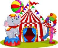 Elefante y payaso del circo con el fondo del carnaval Foto de archivo libre de regalías