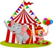 Elefante y payaso lindos de la historieta con la tienda de circo Fotografía de archivo libre de regalías