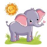 Elefanten står på den soliga ängen Fotografering för Bildbyråer