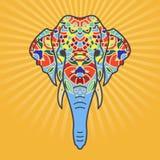 Elefanthuvud med en blom- prydnad fotografering för bildbyråer
