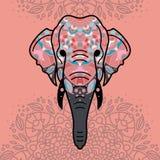 Elefanthuvud med en blom- prydnad arkivfoto