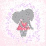 Elefantmädchen mit den geschlossenen Augen, die Blume in ihrer Hand haben Stockbilder