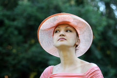 Elegance. Woman in a pink straw hat Royalty Free Stock Images
