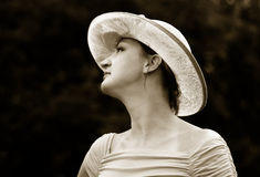 Elegance. Woman in a straw hat Stock Photo