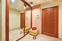 Elegance anteroom interior in warm tones. With hallstand and mirror Royalty Free Stock Image