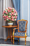 Elegance armchair with beautiful flower bouquet Royalty Free Stock Photo