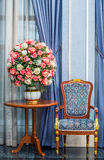 Elegance armchair with beautiful flower bouquet Royalty Free Stock Images
