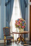 Elegance armchair and flower bouquet on table Stock Photo
