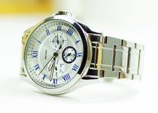 Elegance and beautiful wristwatch. Alarm,analog,chronometer,circle,clock,date,dial  ,elegance  ,elegant  ,hand ,hour Stock Photo
