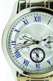 Elegance and beautiful wristwatch. Alarm,analog,chronometer  ,circle,clock ,date,dial  ,elegance,elegant,hand  ,hour,instrument ,jewelry  ,man Stock Image