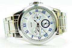 Elegance and beautiful wristwatch. Alarm,analog,chronometer  ,circle,clock ,date,dial  ,elegance,elegant,hand  ,hour,instrument ,jewelry  ,man Royalty Free Stock Photo