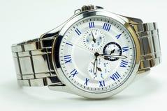Elegance and beautiful wristwatch. Alarm,analog,chronometer  ,circle,clock ,date,dial  ,elegance,elegant,hand  ,hour,instrument ,jewelry  ,man Royalty Free Stock Image