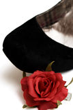 Elegance black shoe with little red rose Stock Photo