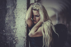 Elegance Blonde angel, young woman with black wings, autumn scen Royalty Free Stock Photography
