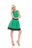 Elegance blonde girl in green dress Royalty Free Stock Image