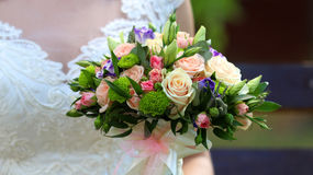 Elegance bouquet in the hands Stock Photography