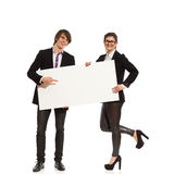 Elegance couple holding blank placard. Young elegance men and women holding blank white placard. Full length studio shot isolated on white Stock Photos