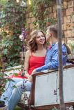 Elegance couple looking each other and enjoy the weekend. Outdoor shot, spring park or summer concept. Love, sensual people Stock Images