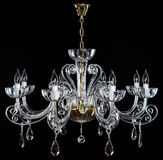 Elegance crystal strass chandelier with eight lamps. Diamond strass chandelier on black background. Isolated retro luxury chandelier over black background Royalty Free Stock Photography
