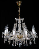 Elegance crystal strass chandelier with eight lamps. Diamond strass chandelier on black background. Isolated retro luxury chandelier over black background Royalty Free Stock Photo