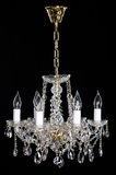 Elegance crystal strass chandelier with eight lamps. Elegance crystal strass chandelier with six lamps. Diamond strass chandelier on black background. Isolated Royalty Free Stock Photos