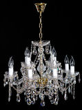 Elegance crystal strass chandelier with eight lamps. Elegance crystal strass chandelier with twelvelamps. Diamond strass chandelier on black background Stock Photos