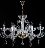 Elegance crystal strass chandelier with six lamps. Diamond strass chandelier on black background. Isolated retro luxury chandelier over black background Royalty Free Stock Images