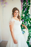 Elegance cute  bride is posing on the background room Royalty Free Stock Images