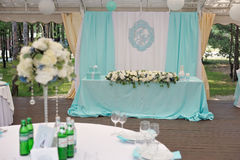 Elegance decorated marrige couple`s wedding table. Elegance decorated with cyan cloth and flowers marrige couple`s wedding table Stock Photos