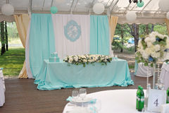 Elegance decorated marrige couple`s wedding table. Elegance decorated with cyan cloth and flowers marrige couple`s wedding table Stock Photography