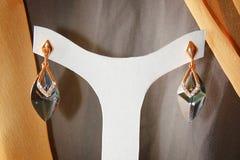 Elegance Earings. Hanged on a white hanger Stock Photo