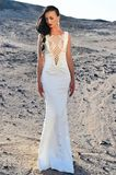 Elegance and fashion model. Wedding fashion and beauty salon. Girl in dress in sunny desert. Woman in white dress in sand dunes. Bride and wedding ceremony Royalty Free Stock Images