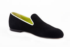 An elegance female shoes isolated. An elegance black and green female shoes isolated Stock Photo