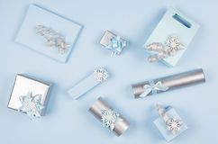 Elegance festive different gift boxes in pastel blue and metallic color with silver shiny ribbons on light blue background. Elegance festive different gift royalty free stock image