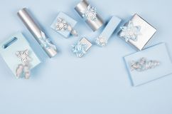Elegance festive different gift boxes in pastel blue and metallic color with silver shiny ribbons on light blue background. royalty free stock photo