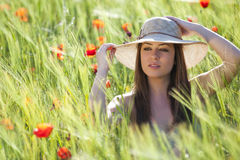 Elegance in field. Young girl portraiting elegance on a green field stock image