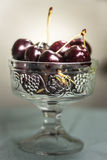 Elegance. The elegance of fresh cherries in a glass bowl Stock Photos