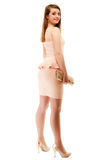 Elegance. Full length of girl in pink dress and with handbag Royalty Free Stock Photography