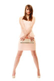 Elegance. Full length of girl in pink dress and with handbag Royalty Free Stock Photo