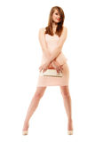 Elegance. Full length of girl in pink dress and with handbag. Female elegance. Full length of attractive girl young woman in elegant light pink dress and with Royalty Free Stock Image